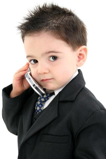 https://beritaunikseru.files.wordpress.com/2011/12/38481-smart-kid-on-the-phone.jpg